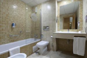 elegante hotel con bañera de hidromasaje privada en Sevilla
